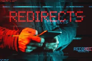 Mobile phone redirects malware concept, low key red and blue lit image and digital glitch effect